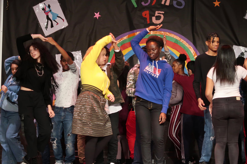 PS/MS 95 students dancing on stage.